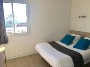 Chambre du Motel Ascot avec un lit pour 2 personnes
